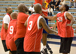 Group of men playing basketball