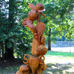 Wooden totem sculpture featuring sports items